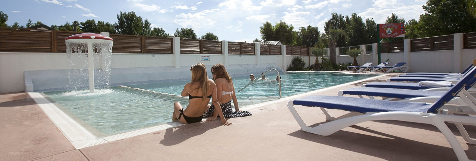 The tranquility at the edge of the heated swimming pool of camping europe argeles beach